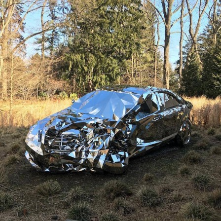 A_Wrecked_Luxury_Car_Built_From_Over_12000_Reflective_Steel_Parts_Mercedes.jpg