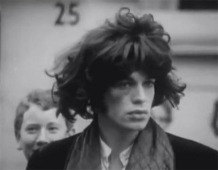 Mick Jagger wearing a Mick Jagger wig during the filming of Performance.gif