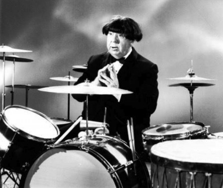 Alfred Hitchcock wearing a Beatles wig.jpg
