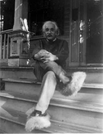 Albert Einstein sitting on the front steps of his Princeton home while wearing his fuzzy slippers.jpg